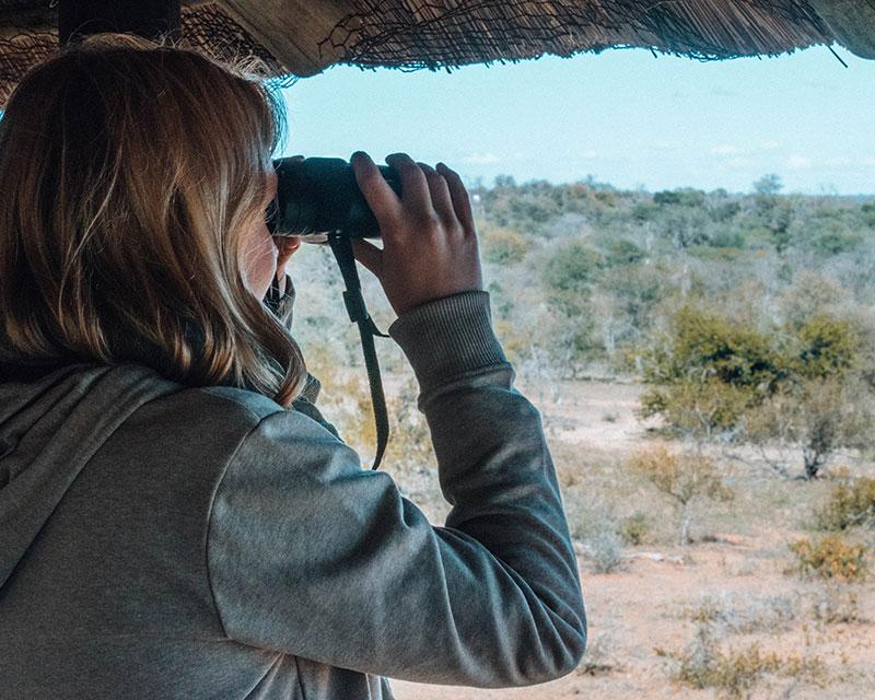 Anna from Really Wildlife - girl on safari with binoculars