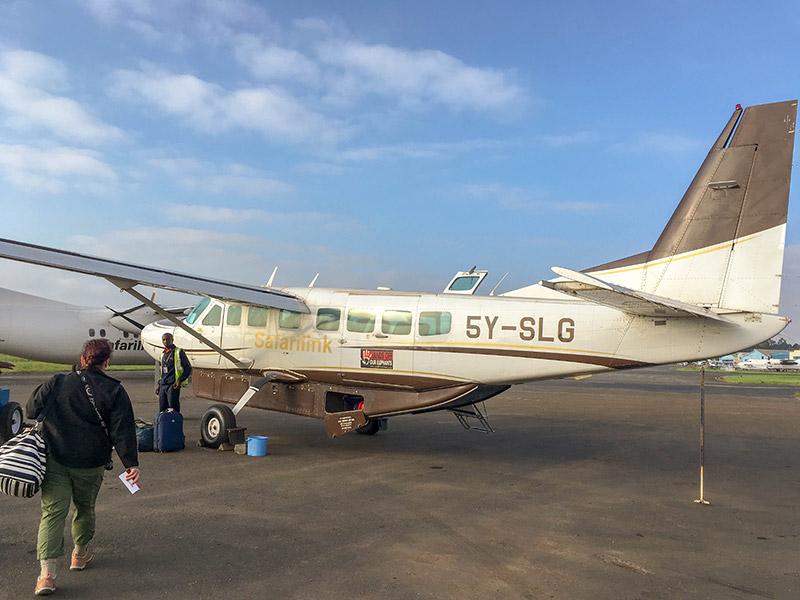 Passengers boarding small Safarilink plane in Kenya at Nairobi Wilson Airport