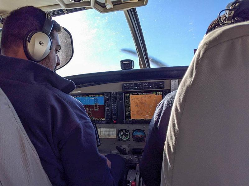 Safarilink pilots looking at instruments in the air over Kenya